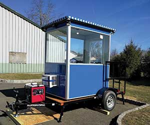 Mobile guard shack mounted on flatbed trailer