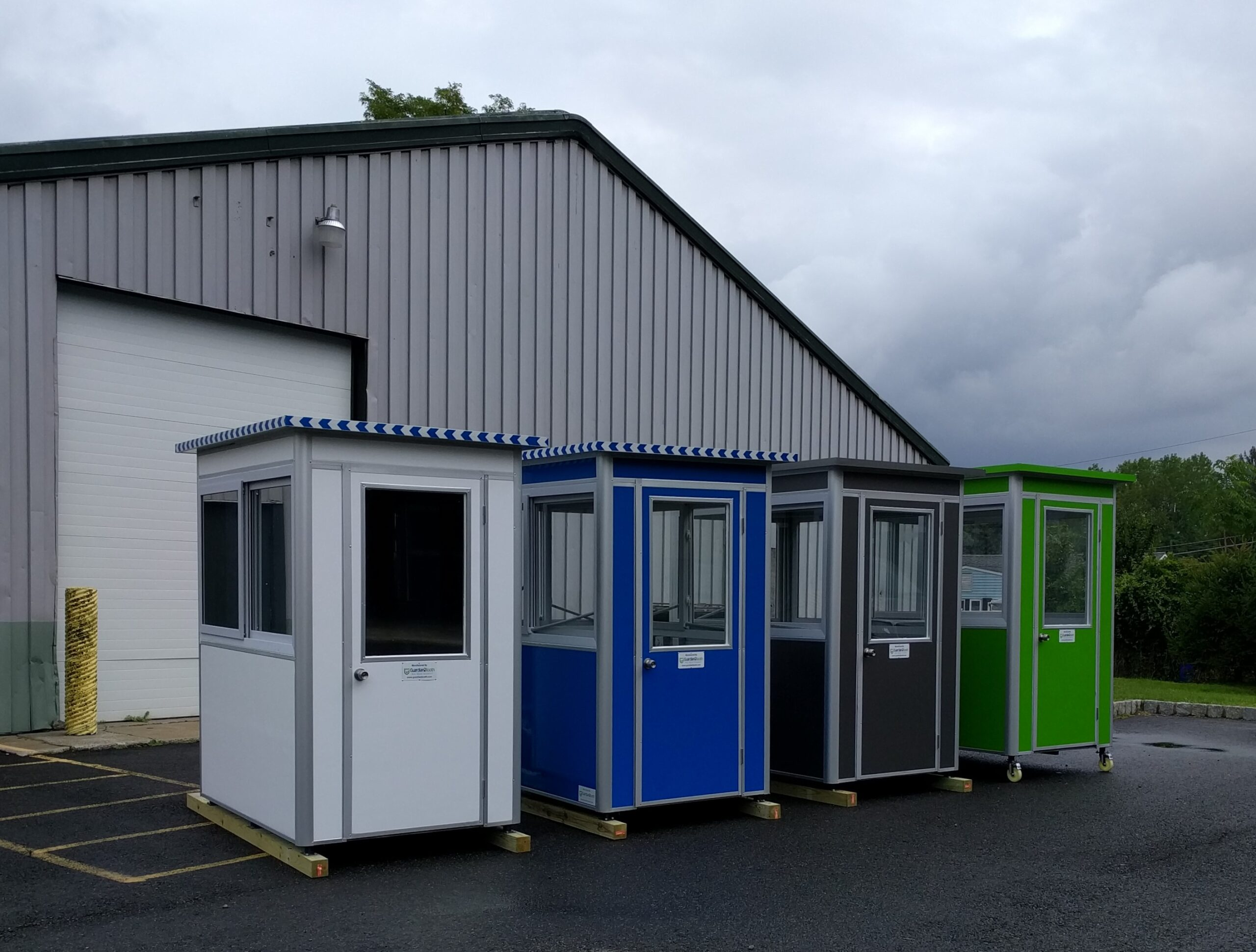 Colored guardian booths outside warehouse