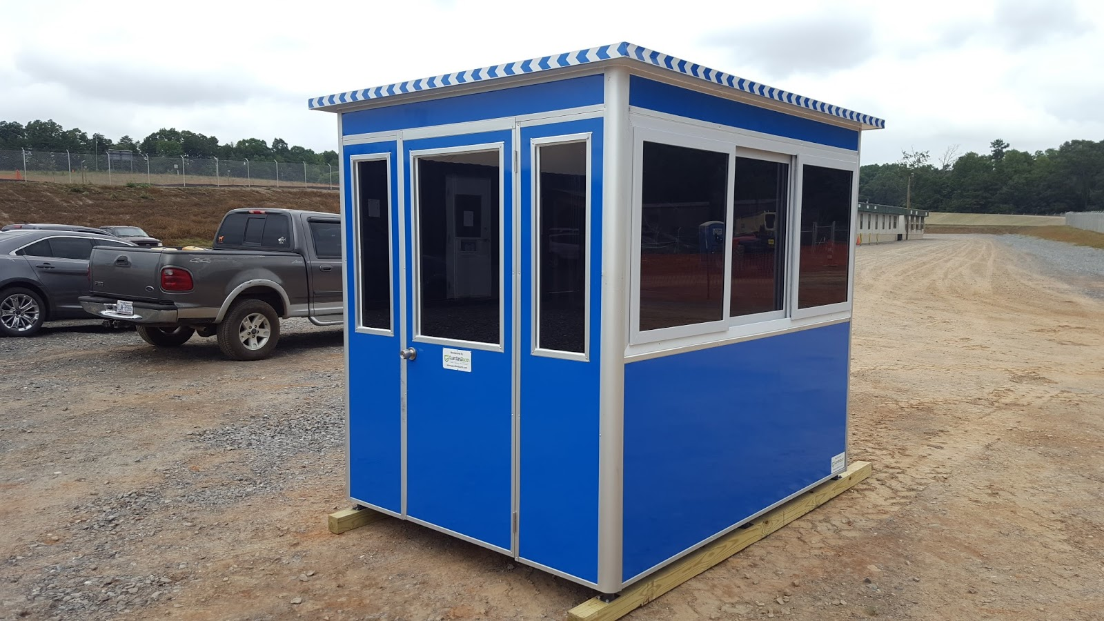 GuardianBooth portable blue guard booth placed at a construction site
