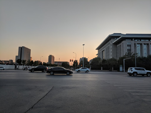 Large parking lot outside a public building
