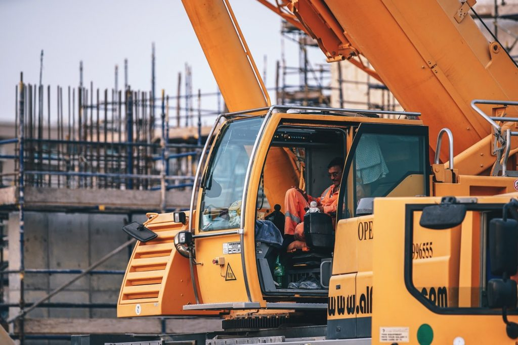 Construction worker sitting in an excavator - Guardian Booth