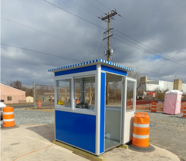 Blue ticket booth outside a parking lot