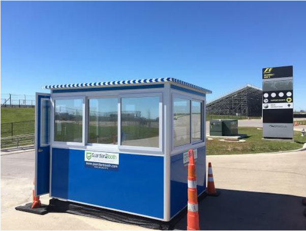 Blue ticket booth outside of a sports center