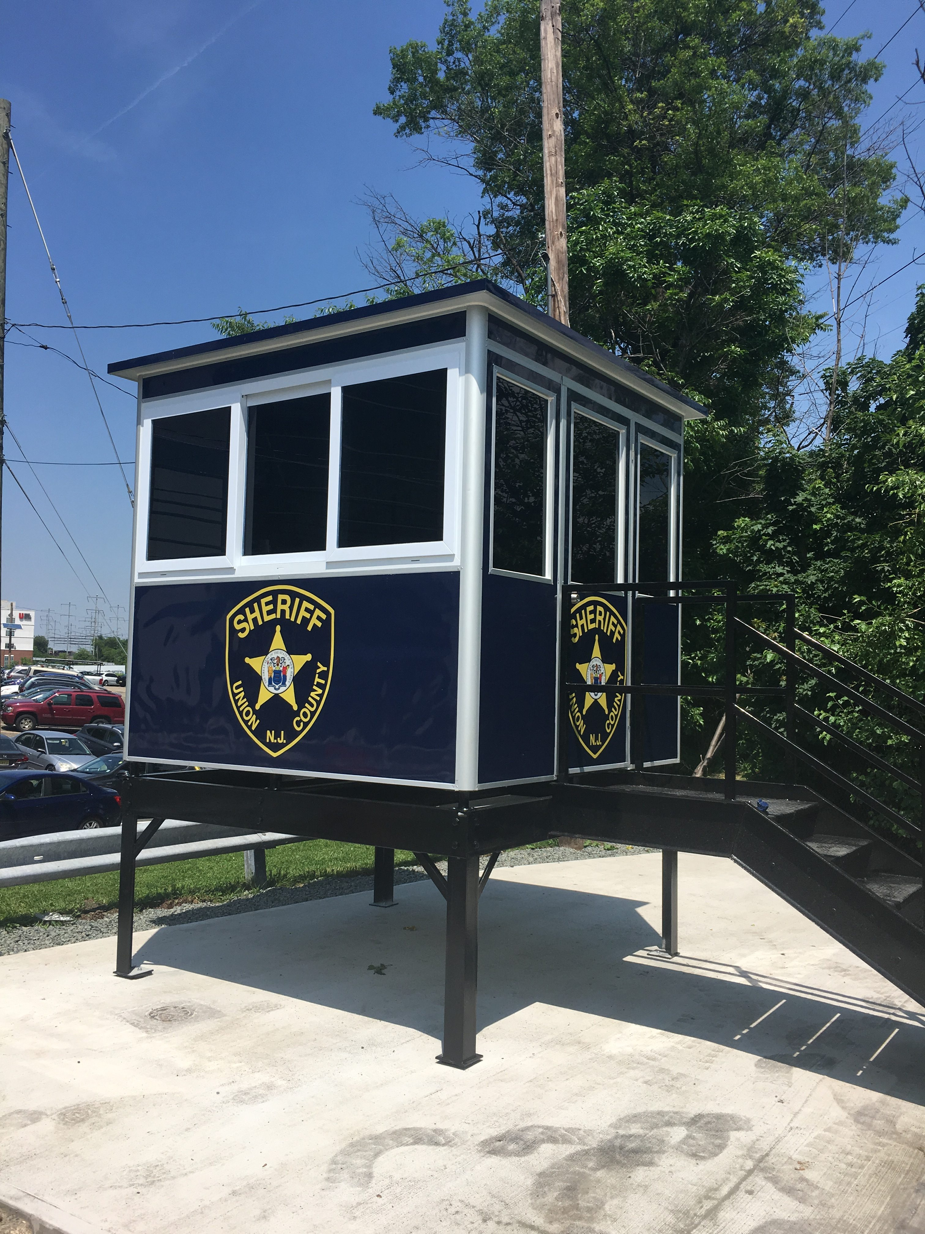 8x8 Security Guard Booth in Elizabeth, NJ with Custon Graphics, Sliding Windows, Tinted Windows, Built-in AC, Baseboard Heaters
