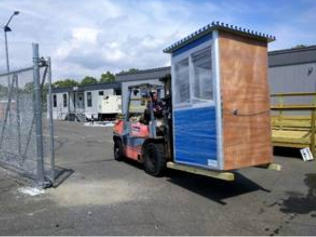 A blue guard booth on a forklift.