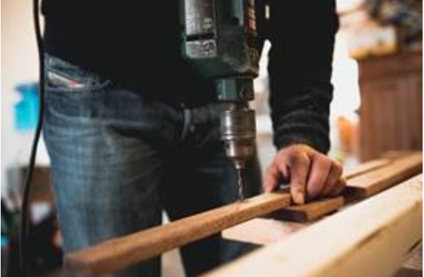 A construction worker working with wood