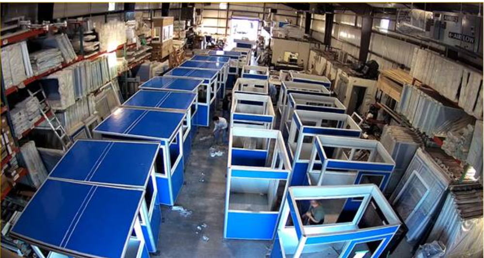 A warehouse full of prefabricated guard booths.