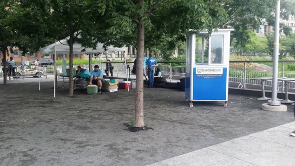 Blue ticket booth in a park - Maximize Profits in Amusement Park Management Systems