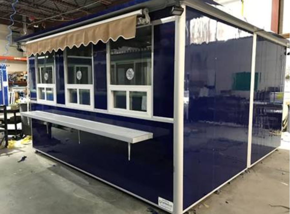 Blue ticket booth with rain awning and customer counter