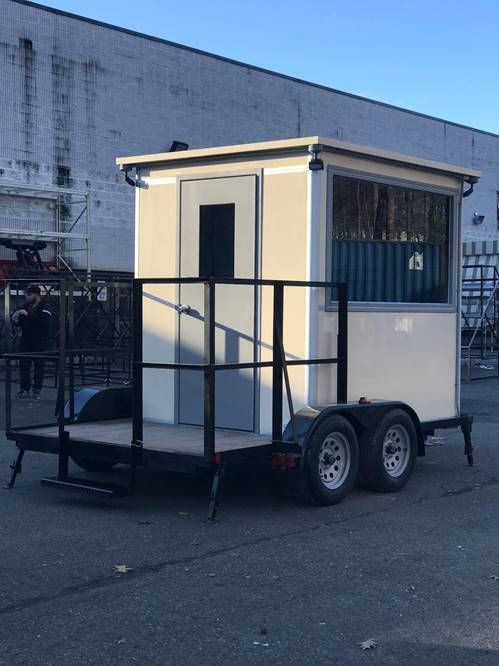 Beige bullet resistant trailer booth manufactrered by Guardian Booth