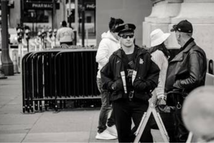 Security guards standing on the street