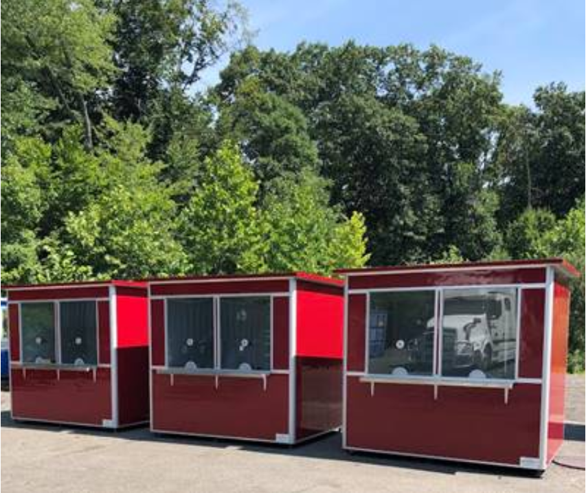 Three bright red ticket booths