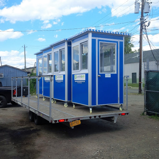 Trailer carrying 4 blue guard booths