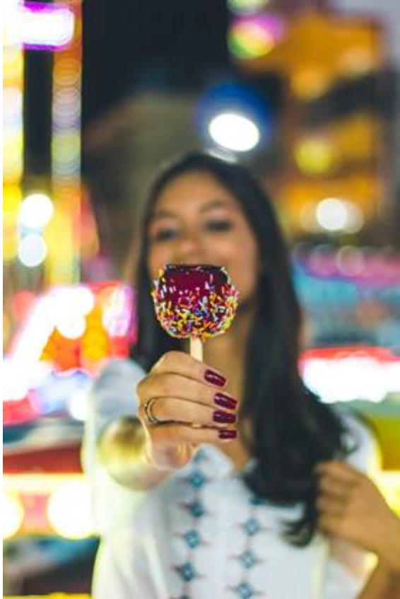 Girl holding colorful toffy