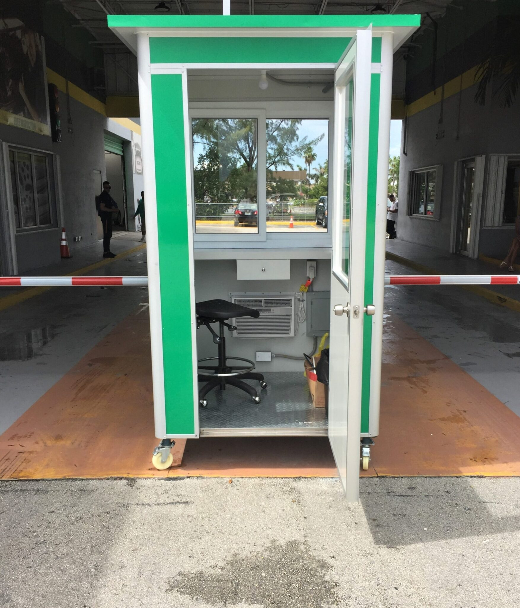 4x4 Parking Booth in Doral, Fl Outside a Car Dealership with Built-in AC, Breaker Panel Box, and Sliding Windows