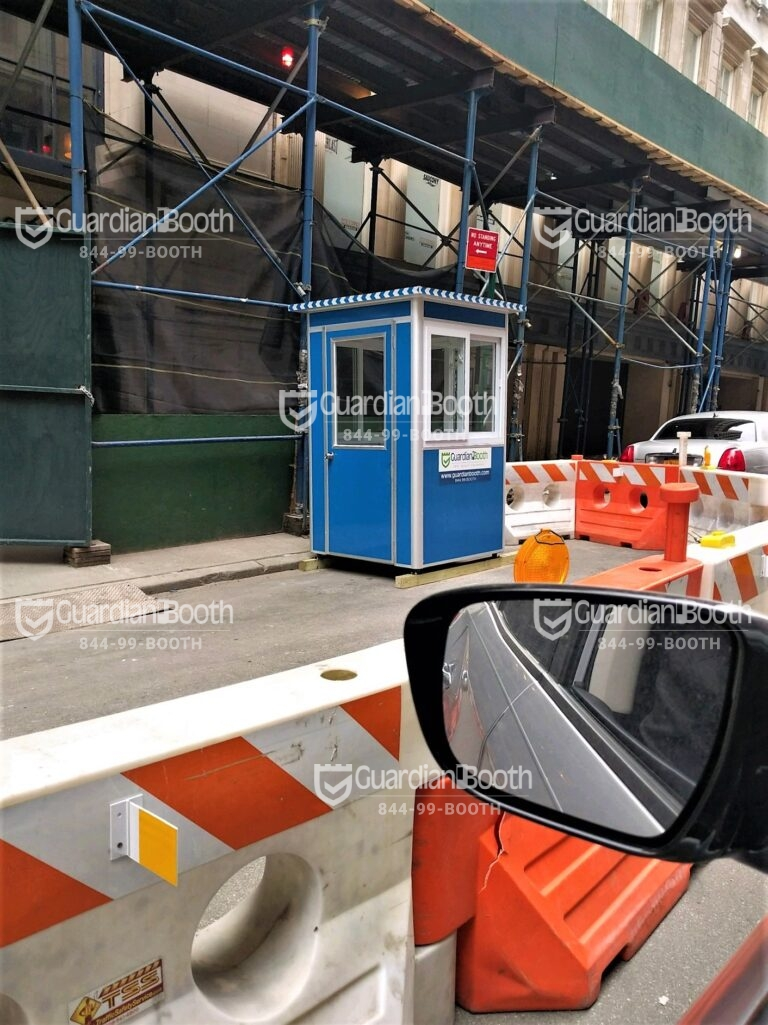 4x4 Security Guard Booth in Manhattan, NY with a Swing Door, Sliding Windows, and Anchoring Brackets