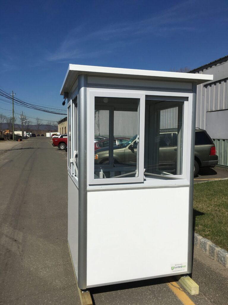 4x4 Security Guard Booth in Portland, OR on Construction Site with Custom Exterior Color, Sliding Windows, and Swing Door