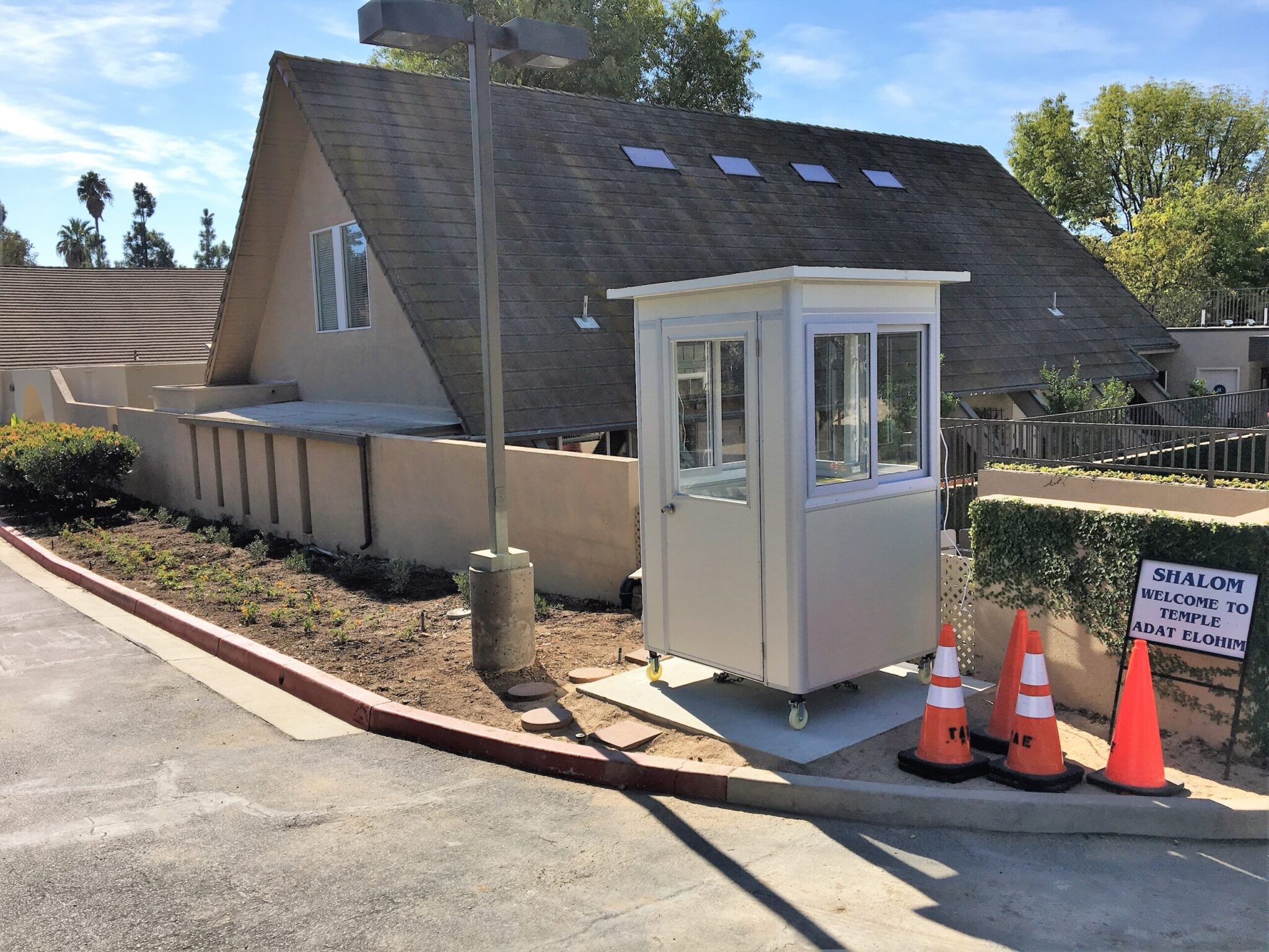 4x4 Security Guard Booth in Thousand Oaks, CA outside a Temple with Caster Wheels, Custom Exterior Color, and Built-in AC