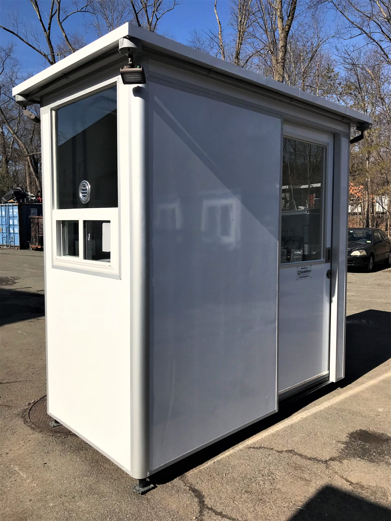 4x6 Cashier Booth with Ticket Transaction Windows, Sliding Door, Outside Spotlights, Custom Exterior Color, and Anchoring Brackets