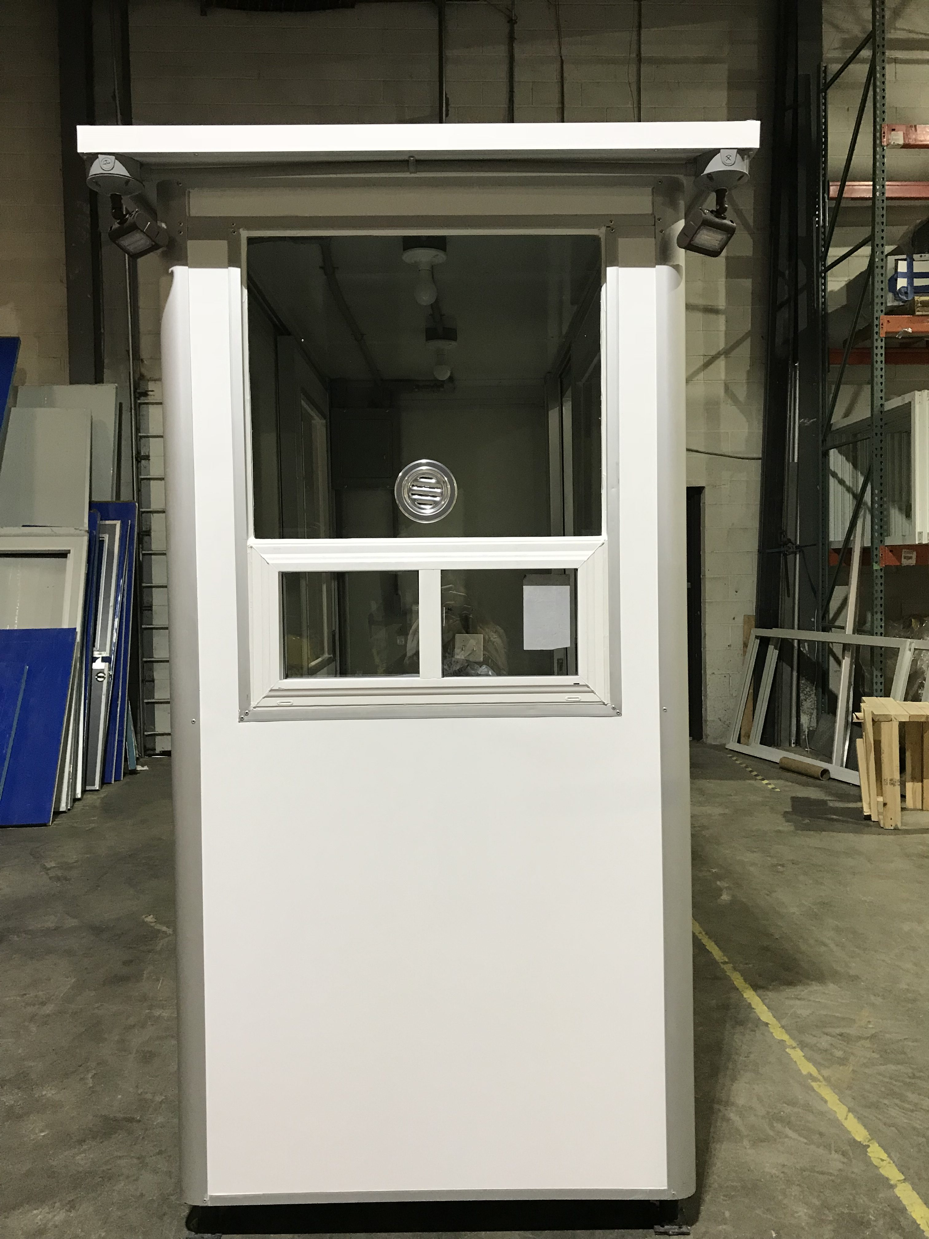 4x6 Cashier Booth with Ticket Transaction Windows, Speaker, Outside Spotlights, Custom Exterior Color, and Anchoring Brackets