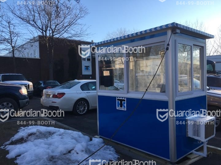 4x6 Parking Booth in Carlstadt, NJ in a parking lot with Sliding Windows, Built-in AC, Baseboard Heaters, and Swing Door