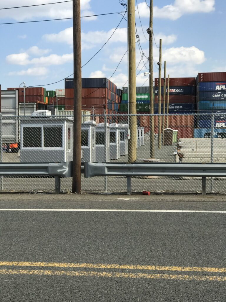 4x6 Security Guard Booths in Port Elizabeth, NJ with Sliding Windows, Swing Doors, and Perimeter Security Fencing