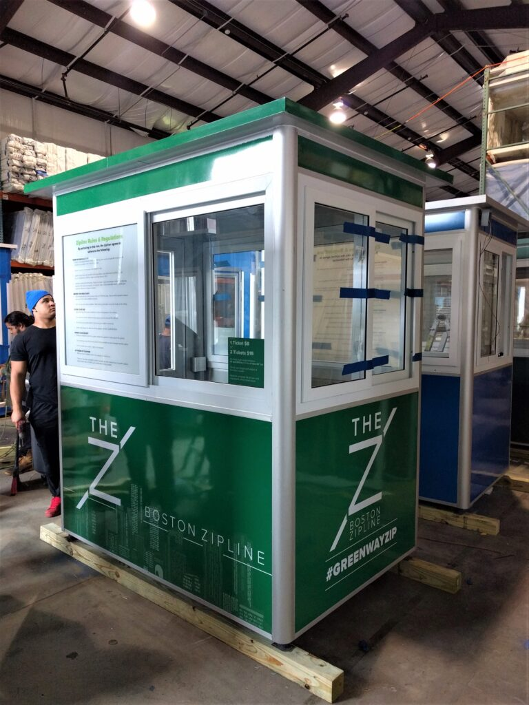 4x6 Ticket Booth in Boston, MA with Custom Graphics, Custom Exterior Color, and Sliding Windows and Swing Door