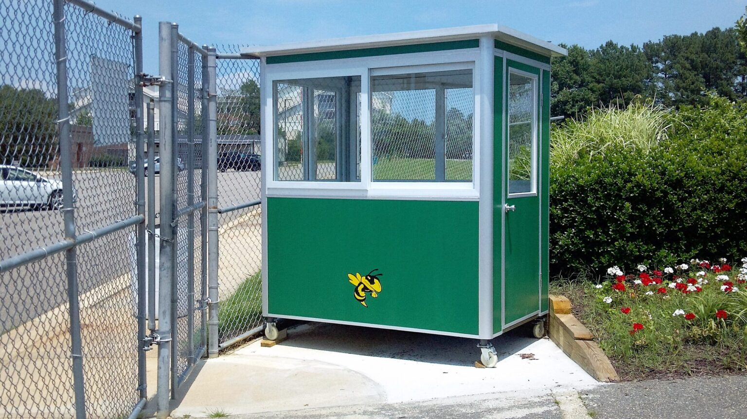 4x6 Ticket Booth in Great Mills, MD outside a School with Caster Wheels, Custom Exterior Color,  and Perimeter Security Fencing