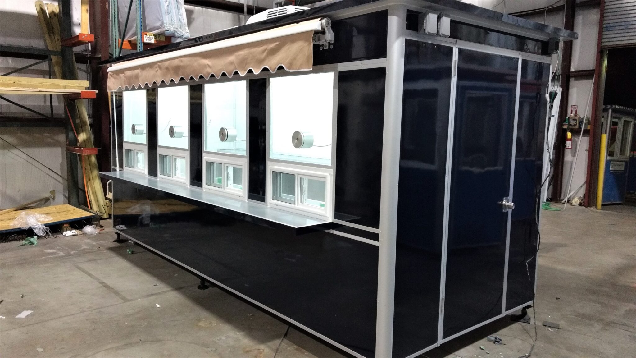 6x16 Ticket Booth in Lynchburg, VA with Awning, Ticket Transaction Windows, Speakers, Breaker Panel Box