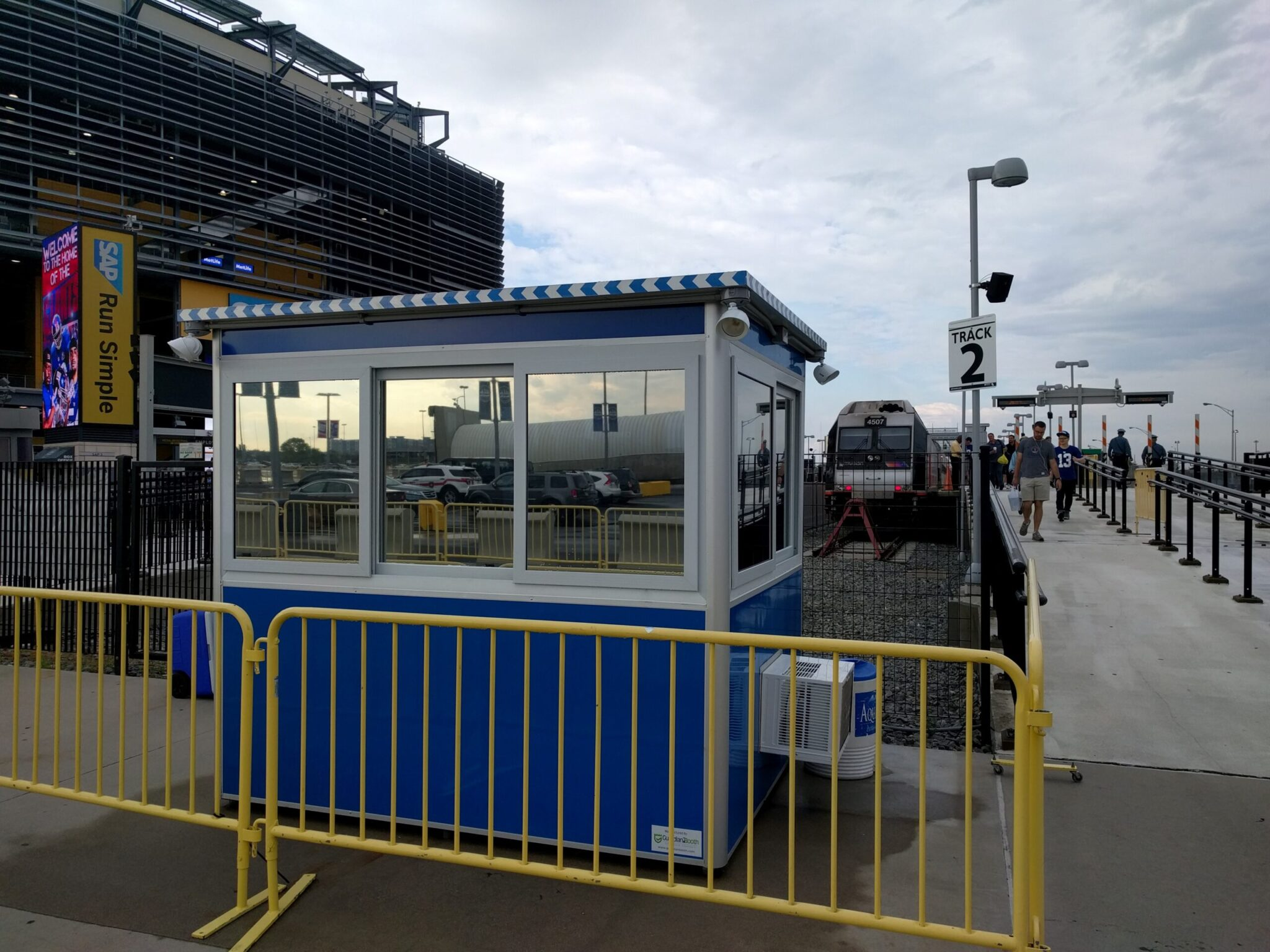 6x8 Security Guard Booth in Rutherford, NJ outside the Stadium with Tinted Windows, Sliding Windows, and Fencing