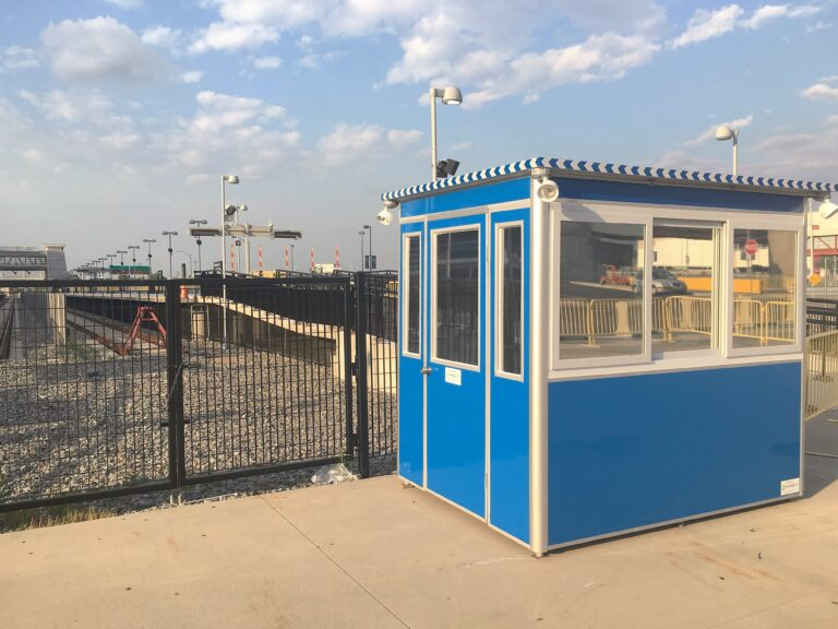 6x8 Security Guard Booth in Rutherford, NJ outside the Stadium with Swing Door, Outside Spotlights, and Perimiter Security Fencing