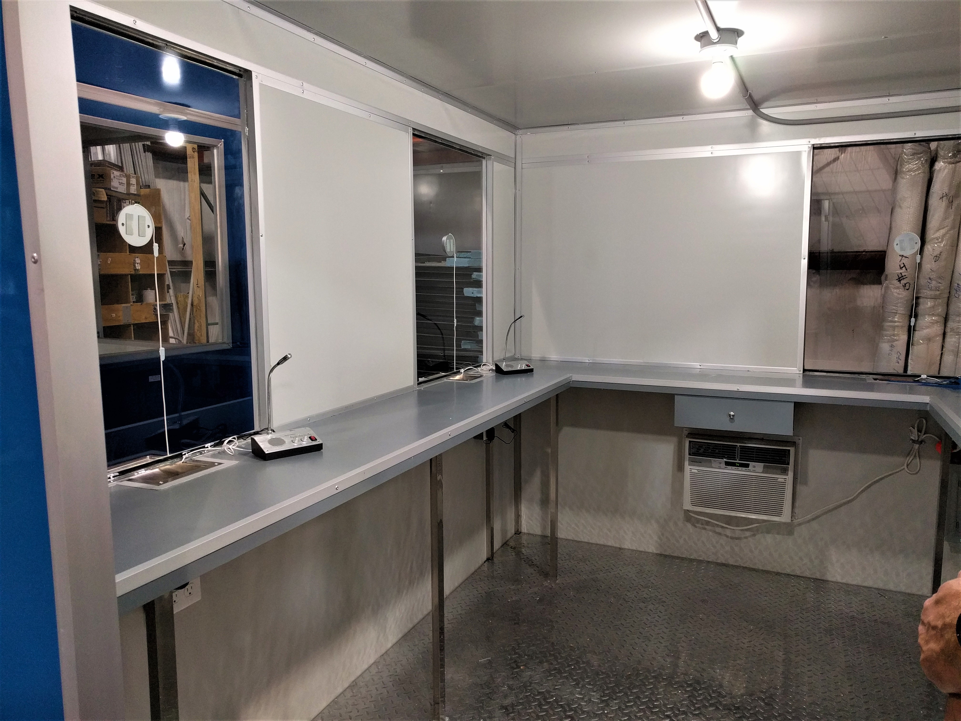 8x10 Ticket Booth in Miramar, FL with Ticket Transaction Windows, Speakers, Extra Desk, Cash Drawer, and Cash Slot