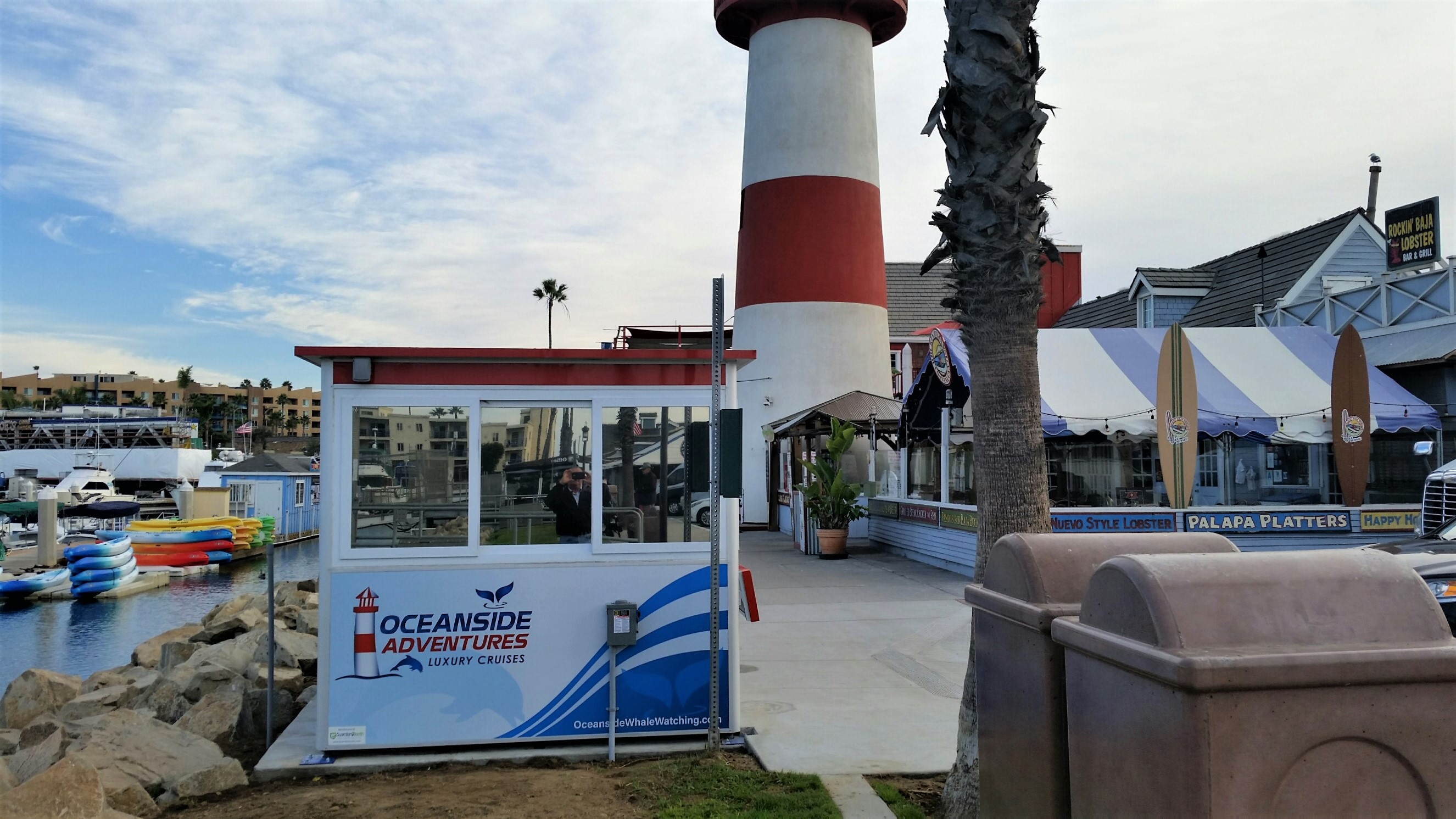 8x10 Ticket Booth in Oceanside,CA outside Harbor with Custom Graphics,Tinted Windows, Anchoring Brackets, Electric Disconnect Switch