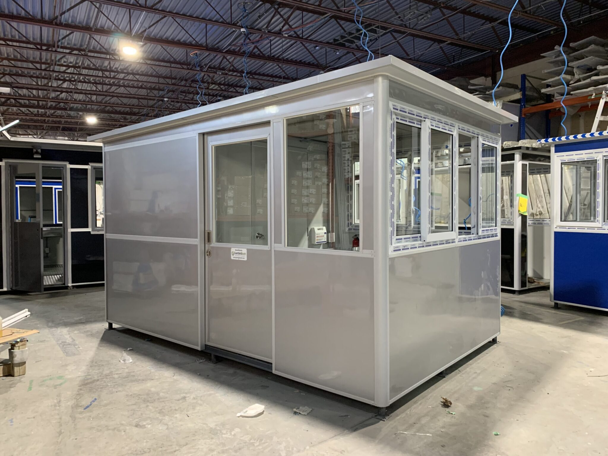 8x12 Security Guard Booth in Talladega, AL with Pitched Roof, Sliding Door, ADA Compliant, and Restroom