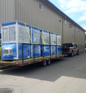 Five blue guard booths ready for delivery.