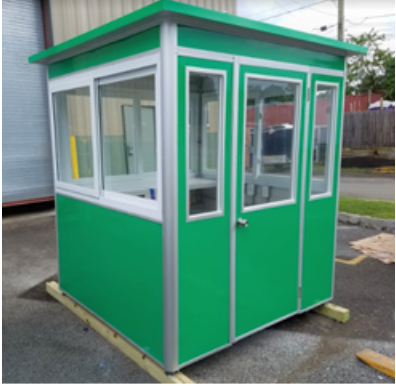 A green booth with a closed swinging door