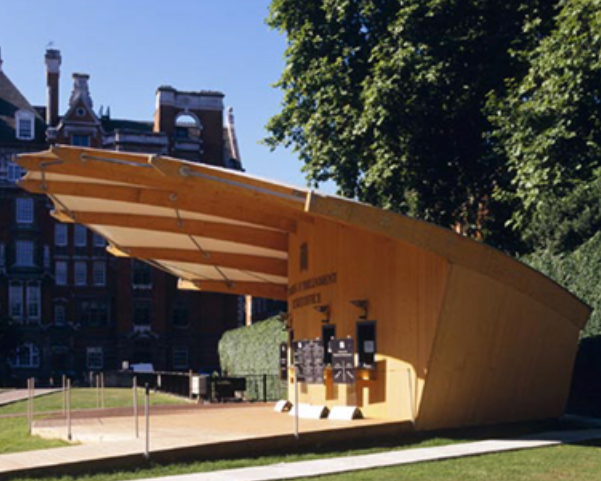 A large wooden ticket booth with large rain awning