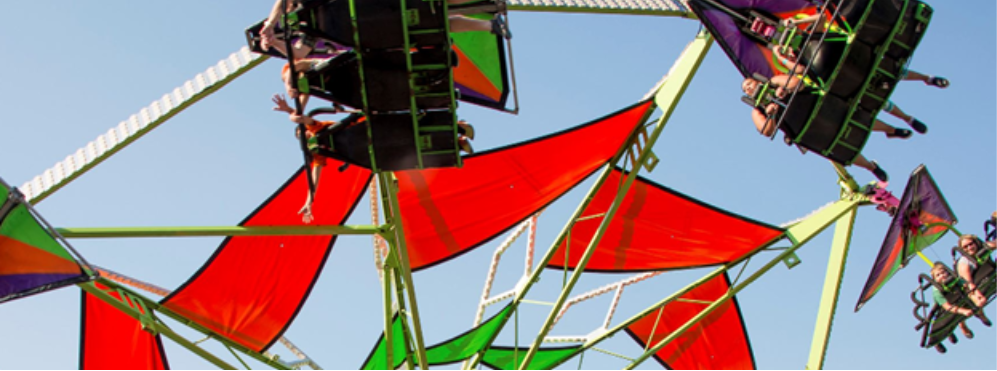 A swinging carnival ride in the air