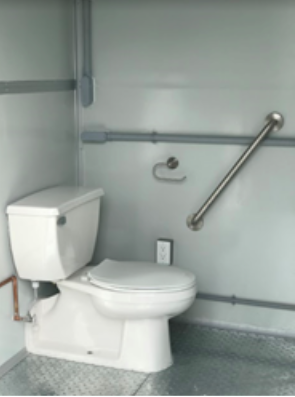 A toilet in a restroom of a modular building
