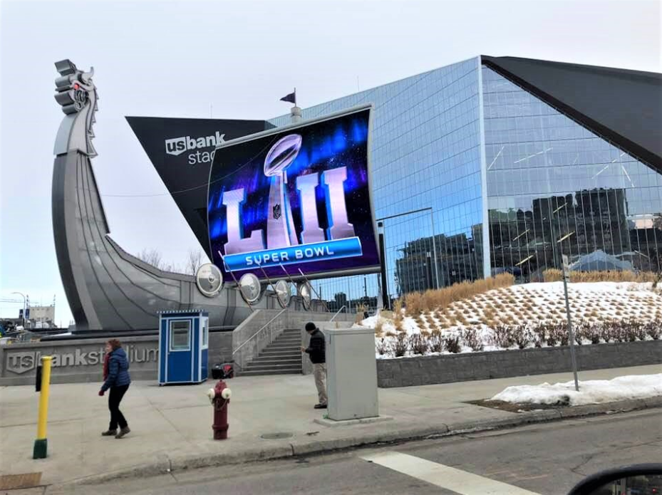 Guardian booth ticket booth outside US Bank Stadium with a Super Bowl sign
