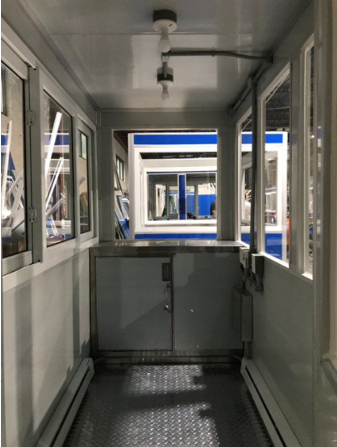 Interior of a ticket booth showing locked cabinet