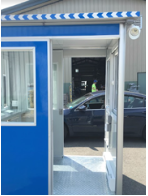 Looking straight through a blue booth with dual open sliding doors