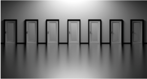 Seven white doors with black outlines lined up in a row