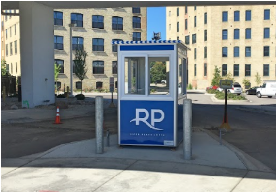 A blue parking booth in a parking lot