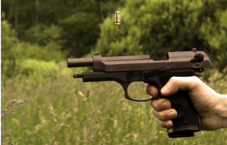 A hand holding a pistol