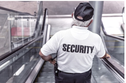 A security guard on an escalator