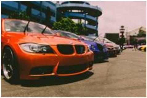 Orange car in a parking lot