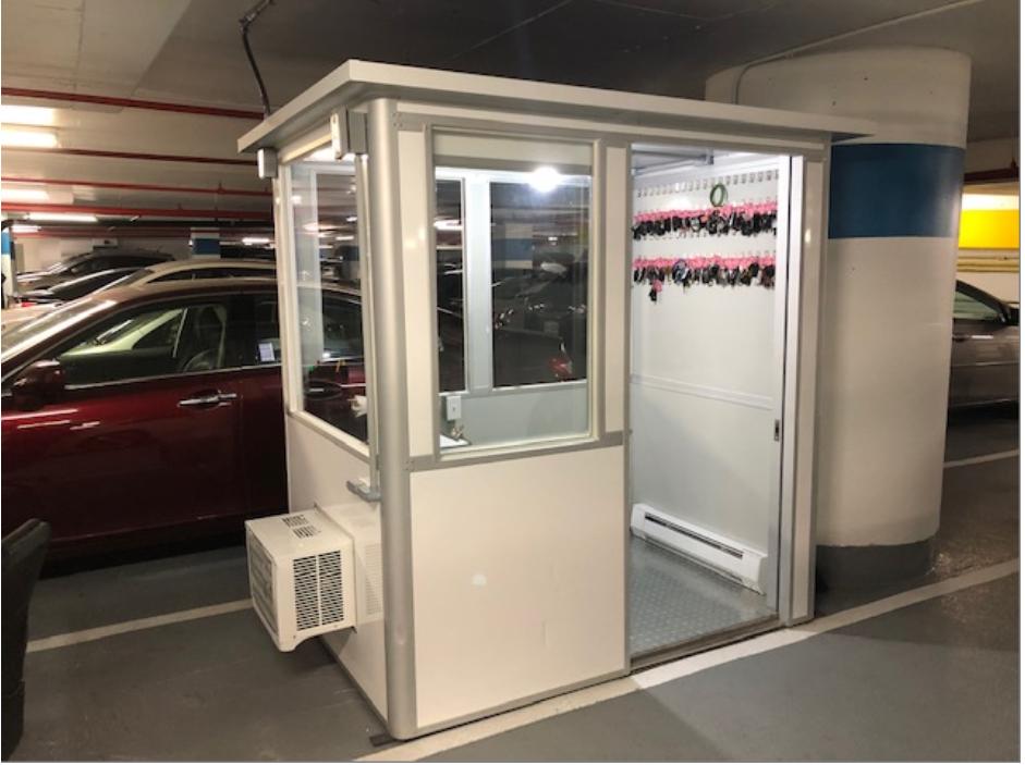 Parking booth with open door