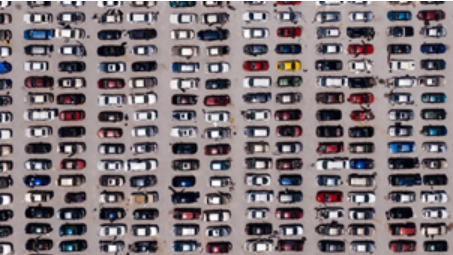 View from above of cars lined up in a parking lot
