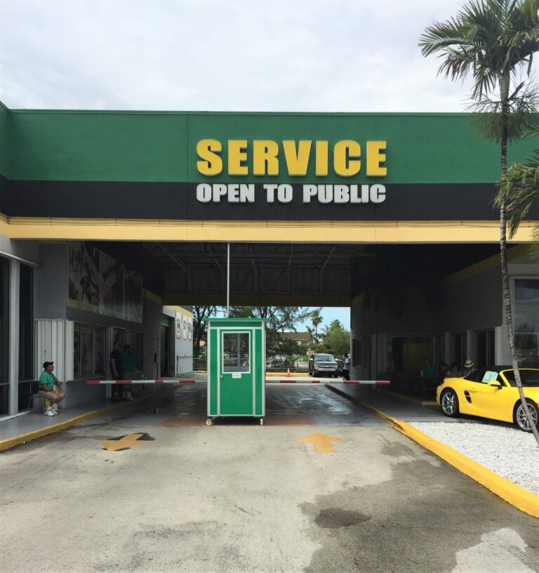 4x4 Parking Booth in Doral, Fl Outside A Car Dealership with Custom Exterior Color, Swing Door, and Caster Wheels